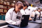 Lenovo workers put together new computers on the company's first U.S. computer manufacturing line in Whitsett.