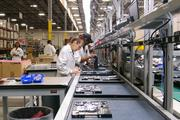Lenovo's first U.S. computer manufacturing line is already pumping out new computers in Whitsett. The PC maker said opening the line in the United States will help the company ship products out to customers more quickly.