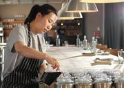 Chef Rachel Yang, of Revel, pours her seasoned soy sauce into trays before dinner service begins.  Every table at Revel has a quartet of house sauces -seasoned soy sauce, spicy chili sauce, savory bean paste sauce, and funky fish sauce with lime and thai chili.