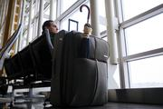 A traveler waits for another flight to New York after a cancellation at Reagan National Airport.