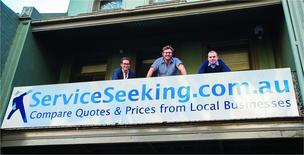 Jeremy Levitt, pictured far left, with staff after the successful launch of his online business, which lets member compare quotes and prices from local companies.