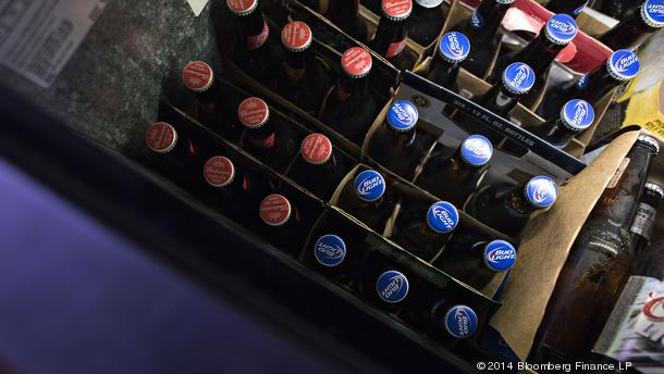 Anheuser-Busch Budweiser and Bud Light brand beers sit in a refrigerator at a bar in Princeton, Illinois, U.S., on Tuesday, Oct. 28, 2014. Anheuser-Busch Inbev SA is scheduled to report quarterly earnings before the market open on Friday, Oct. 31. Photogr