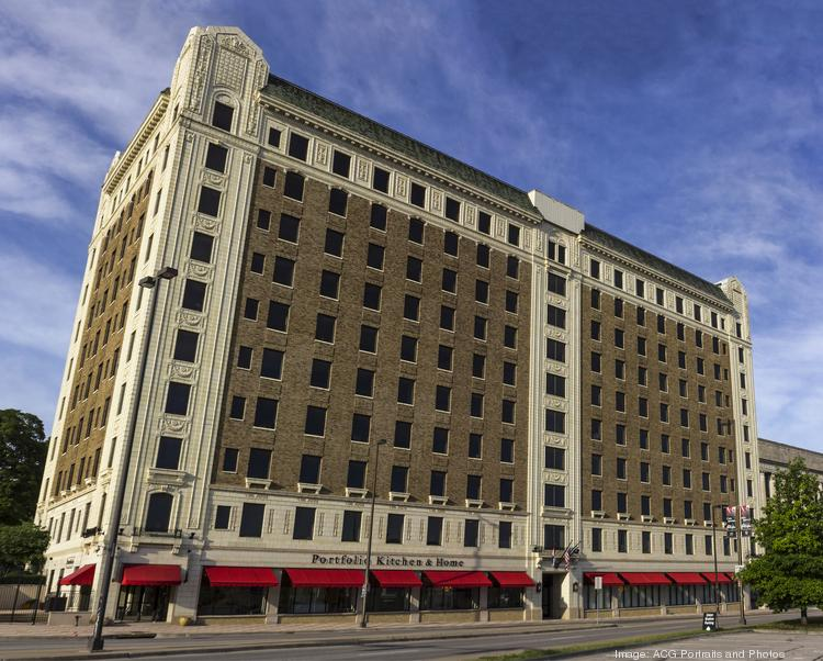 A partnership with a contract to buy a historic 10-story office building across from Union Station has been granted tax increment financing for its plan to convert the top half of the building into market-rate apartments.