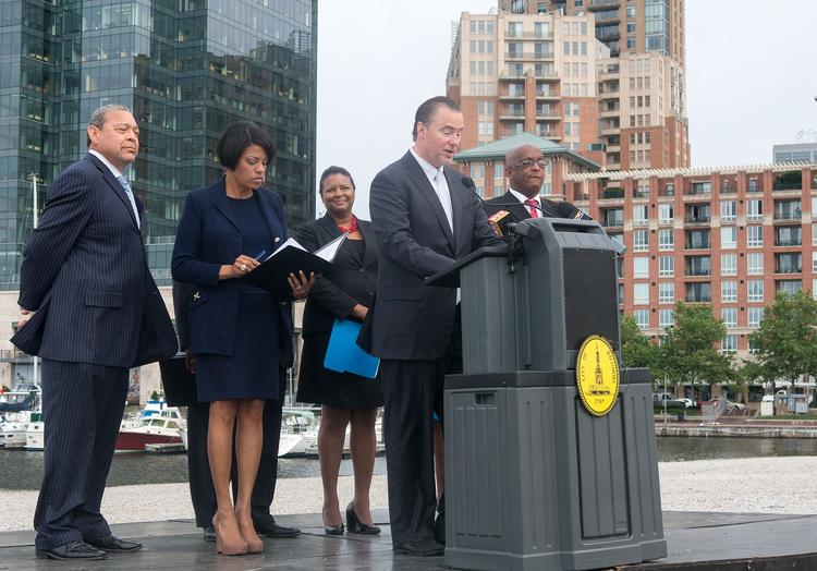 Developer Michael Beatty addresses a news conference on proposed city tax incentives for the Harbor Point development. Mayor Stephanie Rawlings-Blake stands behind him with minority business advocate Wayne Frazier on the far left.