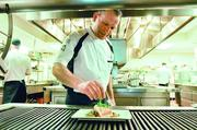 Simon Purvis, executive chef of Four Seasons Denver Hotel, prepares a halibut dish in the kitchen. He will be serving up the restaurant's signature meals and holding cooking demonstrations at the Four Seasons in Tokyo's central business district.