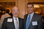 Lyles Carr, left, of The McCormick Group, with Ted Davies of Unisys Federal Systems.