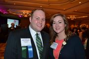 Ron Redmon, left, of Capital One, and Katy Moore of the Washington Area Regional Grantmakers.
