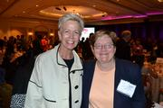 Catherine Meloy, left, CEO of Goodwill of Greater Washington, with Ann Pauley of Trinity Washington University.