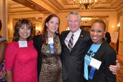 From left, Jeannie Boehne, Kyle Rahn, Bill Hanbury and Kelly Brinkley, all of United Way of the National Capital Area.