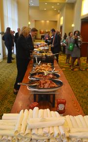 Attendees helped themselves to a morning breakfast of eggs, fruit, bacon and French toast.