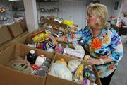Maribeth Phillips, CEO of Meals on Wheels Plus of Manatee Inc., inspects donated food items packed in boxes to be given to the community.