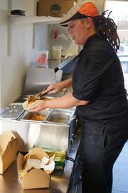 Cooks prepare lunches at Hot Indian Foods