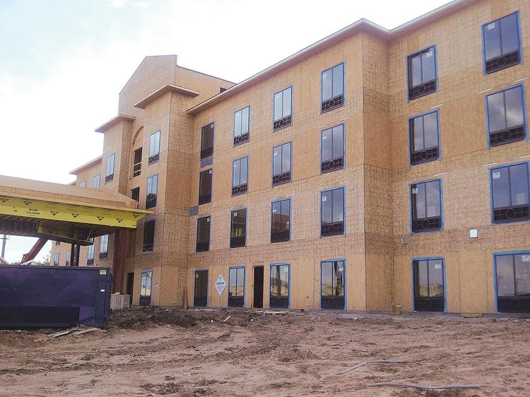 The new Holiday Inn Express Hotel & Suites at 21st and Greenwich opened in September.