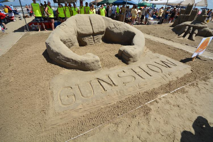 """Freese and Nichols' """"Welcome to the Gun Show"""" received the """"Public Favorite"""" award.  Click through the slideshow to see more photos of the winning sandcastles and the teams behind the creations."""