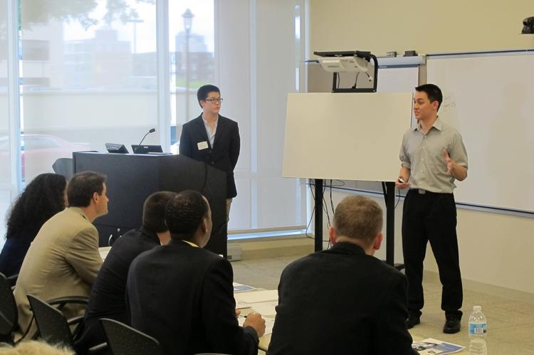 Midwest Social Innovation Startup Challenge competitors Victor Kung (left) and Daniel Yu present their proposal to judges Thursday afternoon for an inventory tracking system for rural health clinics.