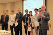Marquette University special adviser to the president Jeff Snell (far right) stands with competition semi-finalists (left to right) Paul German, Mike MacFadden, Ryan Twaddle, Jared Clemens, Yan Wang, Victor Kung and Daniel Yu.