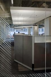 NEEA chose cockpit-style workstations that  to promote collaboration within the cubicle area.