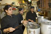 From left to right: Sandeep Kaur, Ranjit Kaur, and Davinder Kaur prepare meals at Shanik Restaurant in Seattle.