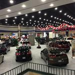 Selling cars and hotel bookings at the auto show
