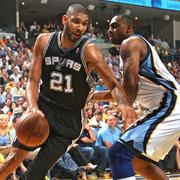 MEMPHIS, TN - MAY 27:  Tim Duncan #21 of the San Antonio Spurs drives under pressure in Game Four of the Western Conference Finals between the San Antonio Spurs and the Memphis Grizzlies during the 2013 NBA Playoffs on May 27, 2013 at FedExForum in Memphis, Tennessee. NOTE TO USER: User expressly acknowledges and agrees that, by downloading and or using this photograph, user is consenting to the terms and conditions of the Getty Images License Agreement. Mandatory Copyright Notice: Copyright 2013 NBAE (Photos by Joe Murphy/NBAE via Getty Images)