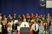 The warm-up act for the president's speech was U.S. Education Secretary Arne Duncan.