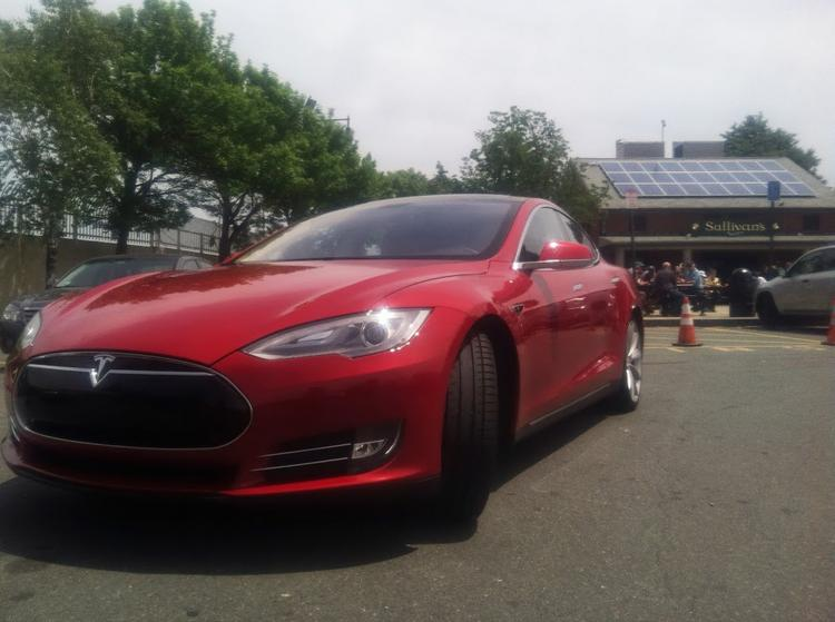 Banned in Massachusetts? The Tesla Model S I test drove, parked at Sullivan's Castle Island. Legislation on Beacon Hill could stop Tesla from cutting out auto dealers in Massachusetts.
