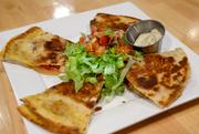 Avenue's annato quesadilla appetizer is a mix of chorizo and barbecue chicken. Prices are in the midrange with appetizers from $5 to $10 and entrees from $6 to $12 and daily happy hour specials.