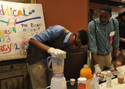 Darick Thomas, CEO of Raddical, an energy drink company, mixes up a smoothie at the Entrepreneuring Youth's second Young Entrepreneur Business Expo held June 6.