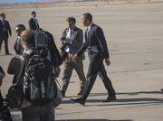 President Obama checks out some of the photographs his personal photographer Pete Souza took during his arrival.