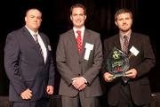 SiteWORX Vice President Joe Smith, left, and President Matt Smith, right, accept the Fast 55 winner's award in the $5.1 million to $10 million category. Presenting the award was Bill Mulvihill, senior vice president of commercial banking at U.S. Bank, a gold sponsor of the event.