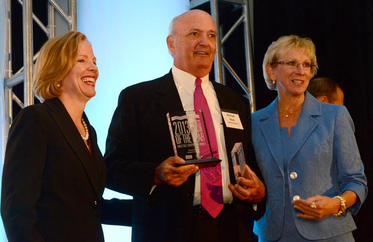 Mary Moore and Nancy Wright Whatley (left) present Michael Nilan his Early Stage Entrepreneur award.