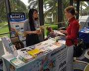 Kimmi Le of LifeExtension explains the company's product to Cassandra Audas of Pro-Lab.