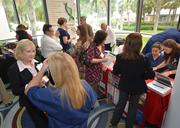 Event attendees visit the tables of the many exhibitors at the health expo.
