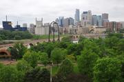 View of the Minneapolis skyline and Stone Arch Bridge from Mill & Main
