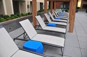 Deck chairs facing the pool