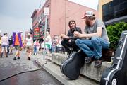 Bluegrass street-performers Kelly Fox, left, and Nathaniel Black enjoy free ice cream in between their performances.