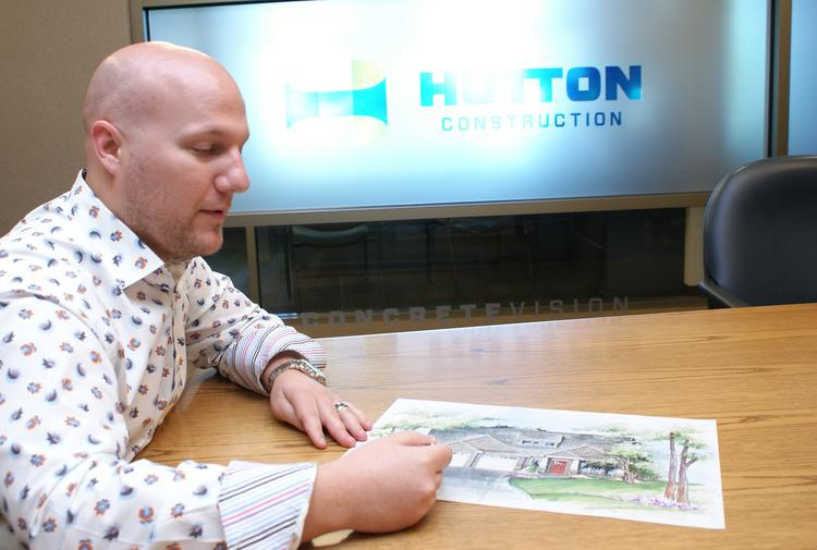Trent Banister, vice president and general manager of Hutton Development, shows a rendering for a patio home in the company's first development, which is breaking ground next month on Central east of Greenwich.