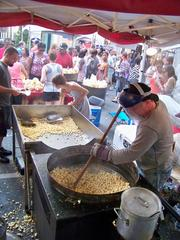 CBJ Seen: Editorial assistant Alison Angel took a walk through the Taste of Charlotte event, which also ran June 7-9 uptown. Here, a man makes Kettle Corn as the crowd lines up for a taste. Click here for more photos from that event.