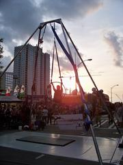 Festival goers pause to watch acrobatics as the sun goes down on Taste of Charlotte.