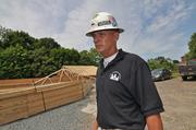 Dennis Hogan, general/construction manager at The Harmony Group, stands next to a wood-frame garage being built next to mill No. 4.