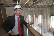 Uri Kaufman, president and CEO of The Harmony Group, stands on the mezzanine of an apartment being built inside mill No. 4. The two-bedroom, two-bath, 1,536-square-foot unit will rent for $1,820.