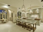 The gourmet kitchen boasts zinc counter tops and Clive Christian cabinetry from England.