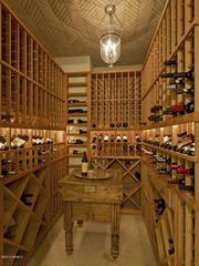 The wine cellar holds up to 1,000 bottles and is big enough for wine tasting events.