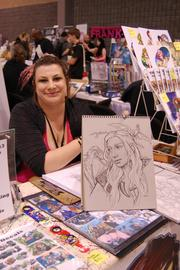 "HeroesCon 2013 ran June 7-9 at the Charlotte Convention Center.  The event was started by Shelton Drum, owner of Heroes Aren't Hard to Find comic shop on Seventh Street in Elizabeth. The annual event includes creators, writers, artists, exhibitors, craftsmen and other vendors. Shown here is artist Vanessa ""Banky"" Farano."