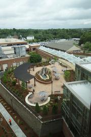 """By the entrance to the North Tower is a """"healing garden"""" with waterfall, as seen here from the sixth floor of the tower."""