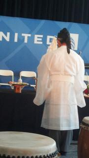 A Shinto priest offers a blessing for the soon-to-depart Tokyo flight. United Airlines and Colorado officials mark the debut of United's Denver-to-Tokyo nonstop service at a pre-flight ceremony at Denver International Airport on June 10, 2013.