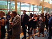 Hundreds wait for the doors to the showcase to open at the Woodlands Waterway Marriott Hotel.