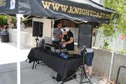A DJ booth plays tunes during UCF's 50th anniversary celebration on campus June 10.