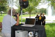 Frank Weber of RF Photography took pictures of attendees at UCF's 50th anniversary celebration on campus June 10.