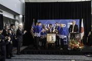 United and local officials, including Denver Mayor Michael Hancock and Gov. John Hickenlooper, cap the pre-flight ceremony by cracking open cask of sake. United Airlines and Colorado officials mark the debut of United's Denver-to-Tokyo nonstop service at a pre-flight ceremony at Denver International Airport on June 10, 2013.